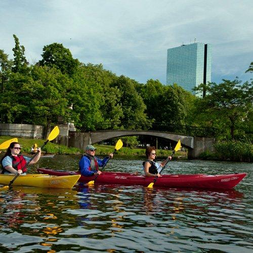 People Kayaking on a Tour around Boston