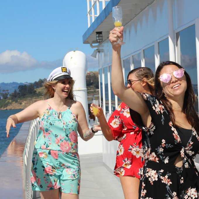Girls enjoying champagne on the sundeck of brunch cruise in SF